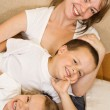 Woman and kids on the sofa — Stock Photo