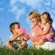 Woman and her kids playing — Stock Photo #6430535