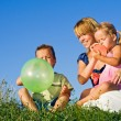 Woman and kids playing with balloons — Stock Photo
