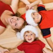 Family on the floor at christmas — Stockfoto