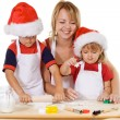 Stock Photo: Family making cookies at christmas time