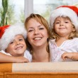 Happy family preparing for christmas — Stock Photo #6430553