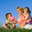 Woman and her kids playing — Stock Photo #6430571