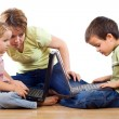 Kids using laptops under adult supervision — Stock Photo #6430575