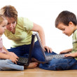 Kids using laptops under adult supervision — Stock Photo