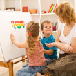 Kids doing math exercises with mom — Stock Photo