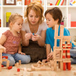 Family activities in the kids room — Stock Photo