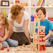 Building with wooden blocks together is fun - Foto Stock