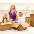 Happy moving in a new home — Stock Photo