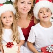 Woman and kids at christmas time — Stock Photo