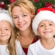 Happy christmas kids and woman — Stock Photo #6430626