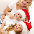 Christmas family relaxing on the sofa — Stock Photo #6430629