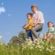 Riding with grandpa on a bike — Stock Photo