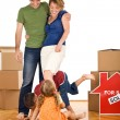 Happy family with kids in their new home — Stock Photo