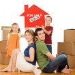 Happy family in their new home — Stock Photo #6430719