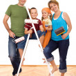 Happy family with painting utensils — Stock Photo