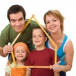 Happy family with their kids - real estate concept - Stock Photo