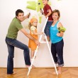 Happy family painting and redecorating - Stock Photo