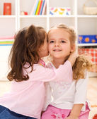 Little girls sharing a delightful secret — Stock Photo