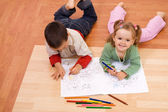 Happy kids coloring the tale book — Stock Photo