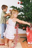Kids decorating the christmas tree — Stock Photo
