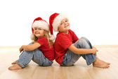 Happy christmas kids sitting on the floor — Stock Photo