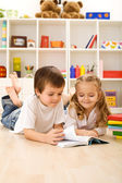 Little sister let me show you how to read — Stock Photo