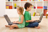 Kids with laptops - computer generation — Stock Photo