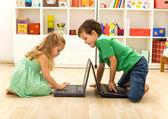 Kids playing on laptops — Stock Photo