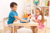 Siblings playing chess in the kid's room — Stock Photo