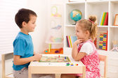 Kids playing board game in their room — Stock Photo