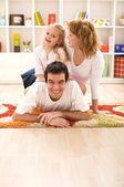 Happy family having fun together — Stock Photo