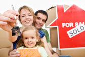 Happy new homeowners - family moving concept — Stock Photo