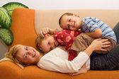 Happy woman and kids having fun indoors — Stock Photo