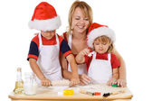 Family making cookies at christmas time — Stock Photo