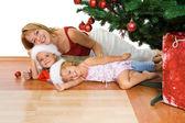 Christmas bunch under the fir tree — Stock Photo