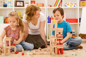 Building with wooden blocks together is fun — Zdjęcie stockowe