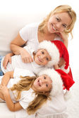 Christmas family relaxing on the sofa — Stock Photo
