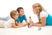 Woman telling a story to her kids on the floor — Stock Photo