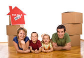Happy family in their newly bought house — Stock Photo