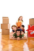 Happy family in their new home — Stock Photo