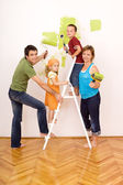 Happy family painting and redecorating — Stock Photo