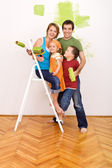 Happy family before redecorating their home — Stock Photo