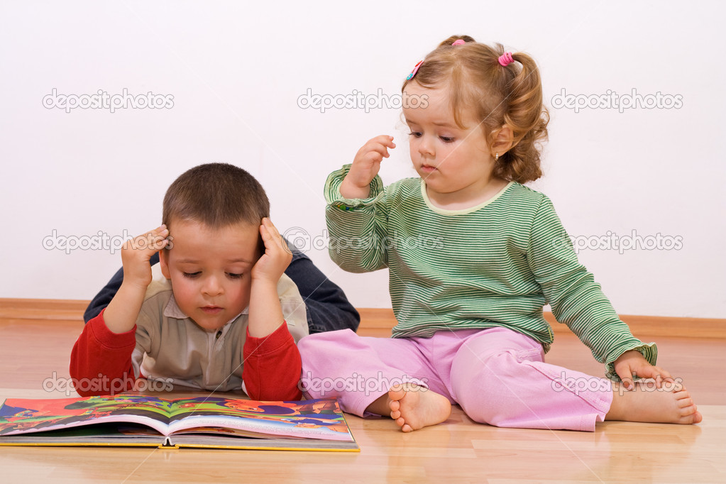 Two kids reading the tale book — Stock Photo #6430074