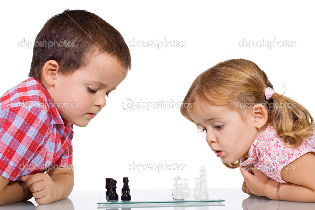 Concentrated kids playing chess - isolated — Stock Photo #6430107