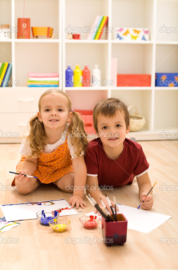 Young artists - kids painting sitting on the floor in their room  Stock Photo #6430217