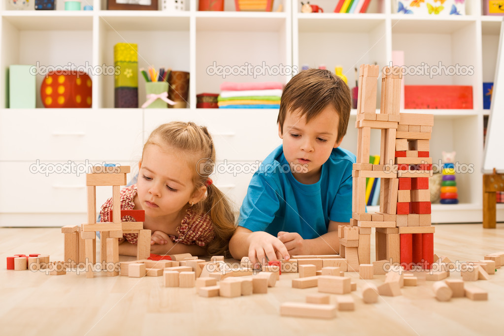 Kids inspecting their wooden block buildings - childhood activities  Stok fotoraf #6430224