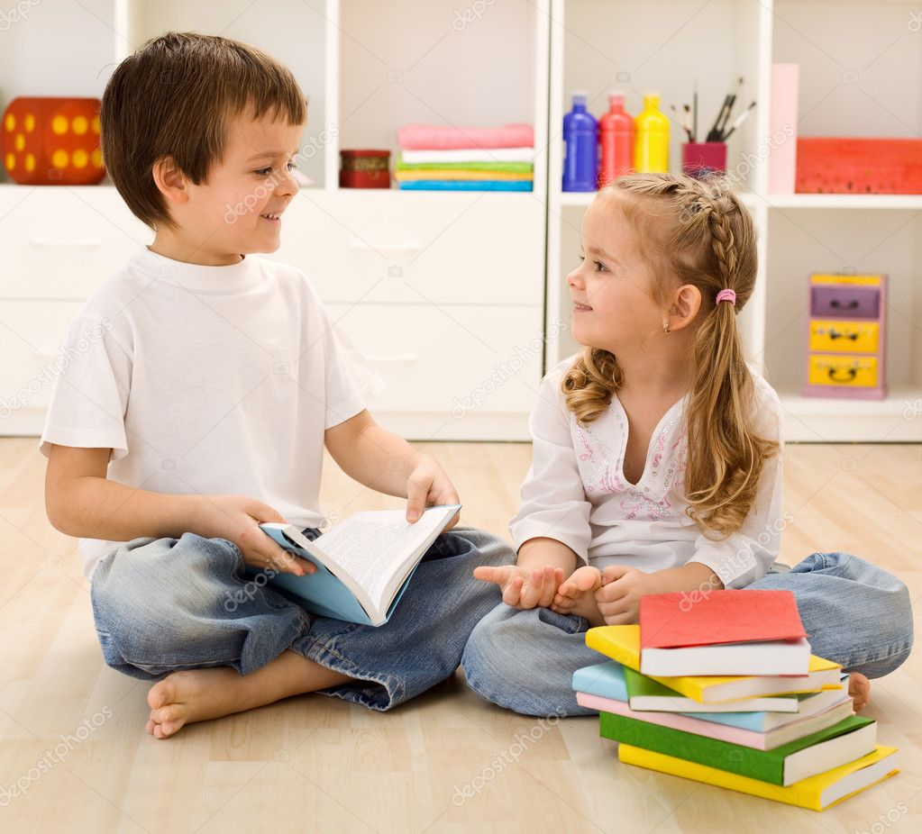 Let me tell you about school - siblings with books talking at home, back to school concept  Stock Photo #6430307