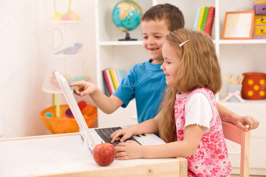 Kids playing on laptop computer at home together — Stock Photo #6430355