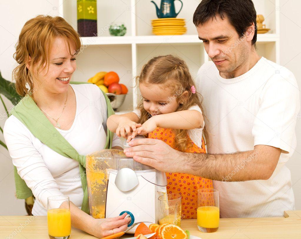 family making fresh fruit juice together  stock photo © ilona, Kitchen design